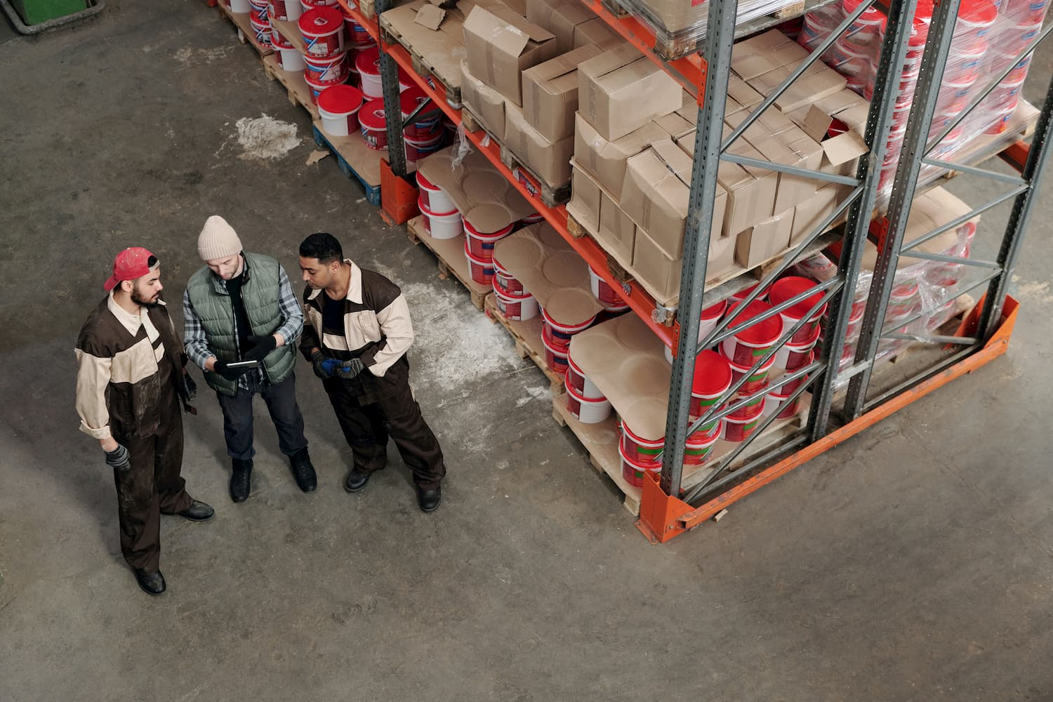 men-standing-in-a-warehouse-talking-4480984 (1)